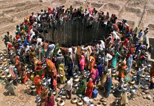 Parched villagers mob a village well in Natwargadh, Gujarat.