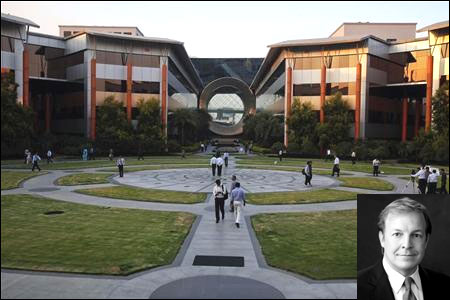 Employees walk in front of a building dubbed the ''washing machine'', a well-known landmark built by Infosys. Inset: Stephen Pratt.