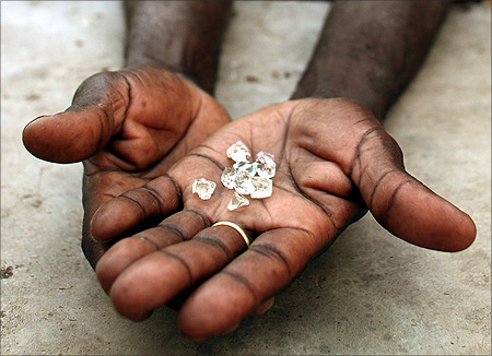 An illegal diamond dealer from Zimbabwe displays diamonds for sale in Manica, near the border with Zimbabwe