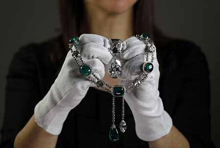Curator Caroline de Guitaut poses with the Cullinan VII necklace at the Queen's Gallery in Buckingham Palace in London
