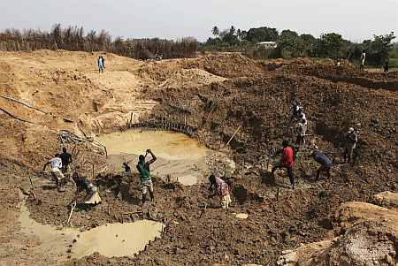 Artisanal diamond miners work at Tumbodu, north of the town of Koidu in eastern Sierra Leone