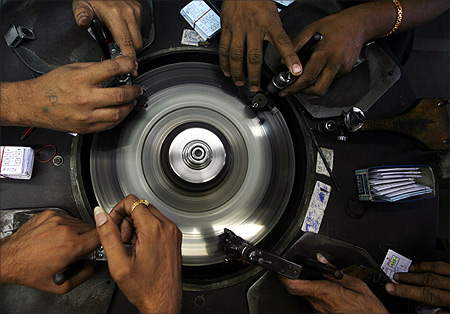Employees work at a diamond factory in Surat