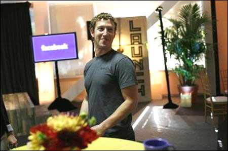Facebook CEO Mark Zuckerberg walks through Facebook headquarters.