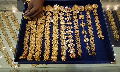 A salesman displays gold jewellery for the camera at a showroom in the southern Indian city of Hyderabad.