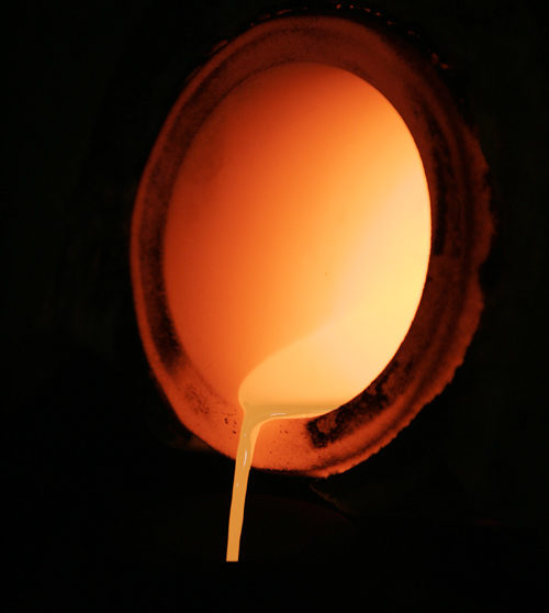 Highly pure molten gold for use in electronic devices is poured at a Tanaka Kikinzoku Kogyo factory in Kanagawa prefecture.