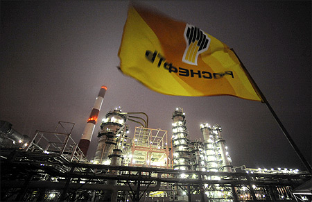 Flag with the logo of Rosneft, Russia's largest oil company, flutters over the Novokuibyshevsk refinery near the city of Samara.