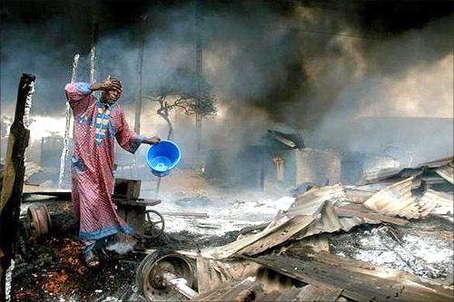 A man rinses soot from his face at the scene of a gas pipeline explosion near Nigeria's commercial capital Lagos.