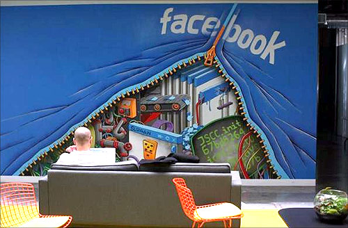 An employee works on a computer at the new headquarters of Facebook in Menlo Park.