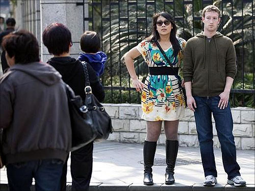 Facebook CEO Mark Zuckerberg and his girlfriend Priscilla Chan walk near Fuxing Road in Shanghai.