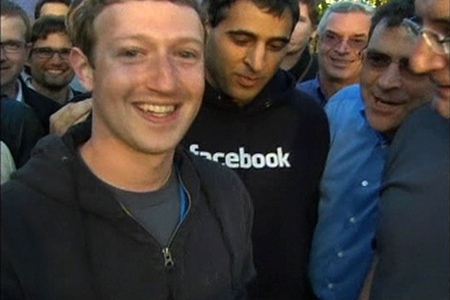 Facebook Chief Executive Mark Zuckerberg, shown in this image from Reuters video, reacts after remotely ringing the Nasdaq's opening bell at the social network's headquarters in Menlo Park, California.