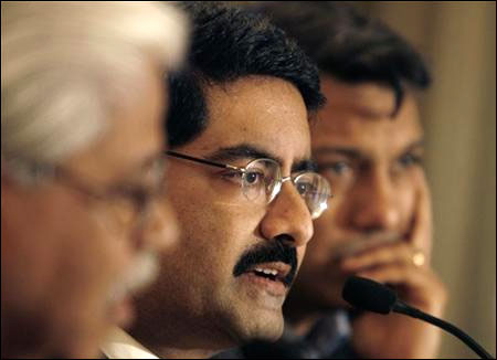 Kumar Mangalam Birla (C) speaks during a news conference in Mumbai.