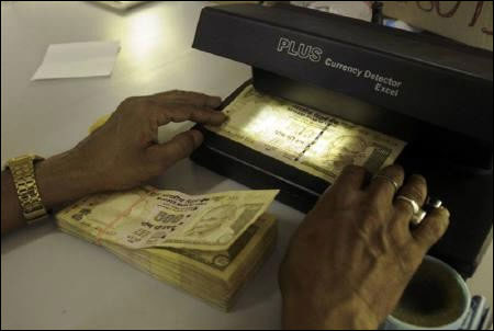 Why the rupee is likely to hit 60/UD$