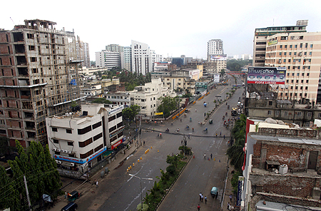A usually busy Dhaka street is empty during a strike.