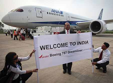 The president of Boeing India poses in front of the Boeing 787 Dreamliner.