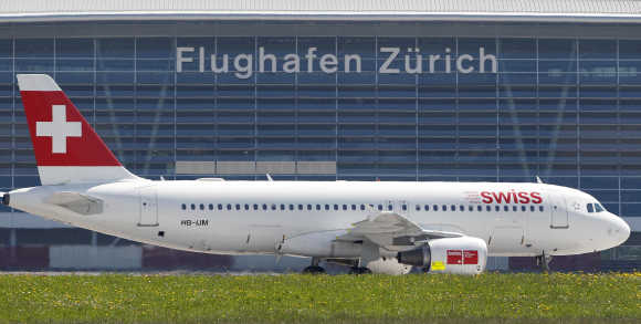 A jet of Swiss airlines rolls on Zurich airport's tarmac in Kloten.