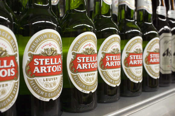 Bottles of Stella Artois beer are displayed for sale at a store in Hong Kong.