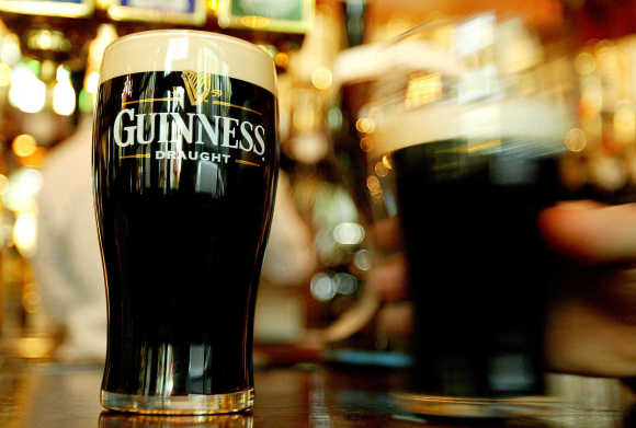A view of pints of Guinness in a London pub.