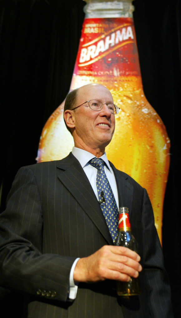 InBev CEO John Brock holds a bottle of Brahma beer in New York.