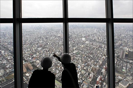 Reporters observe a panoramic view of the city of Tokyo from the first observatory deck
