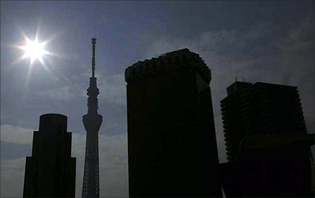 An eclipse is seen over Tokyo Sky Tree