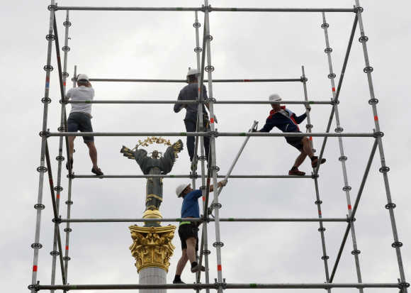 Workers assemble a stage in Independence Square in central Kiev, Ukraine.
