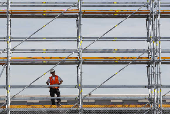 A worker takes a break while working at a construction area at Munich's airport.