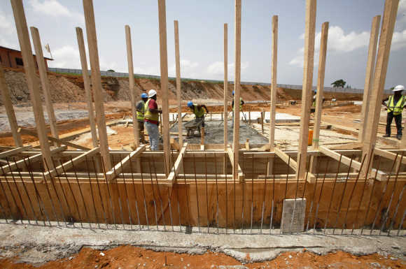 Workers are seen at the construction site of Abidjan's third bridge, in Cocody-Golf, Abidjan, Ivory Coast.