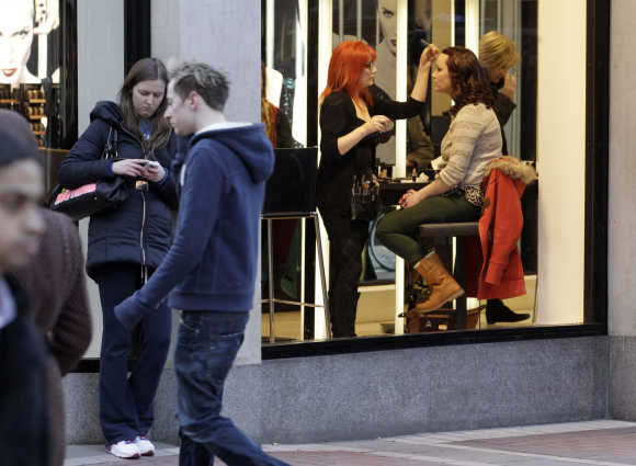 A woman has her make up applied in the Brown Thomas department store on Grafton Street in central Dublin.