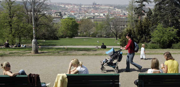 People enjoy a sunny day in Prague.