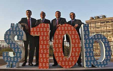 A file photo shows Tata Consultancy Services executives celebrate the magical $10-billion mark in its turnover.