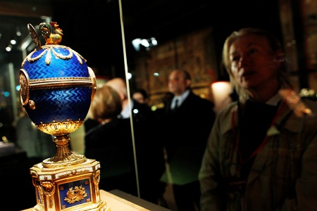 A visitor looks at 'The Kelch Chanticleer Egg' on display at the exhibition 'Faberge. The Sacred Images' , in the Vatican Museums at the Vatican.