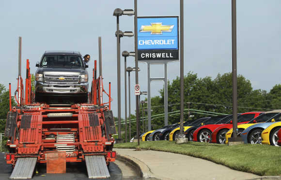 Driver Campbell unloads a Chevrolet Silverado pickup truck at Criswell Chevrolet in Maryland.