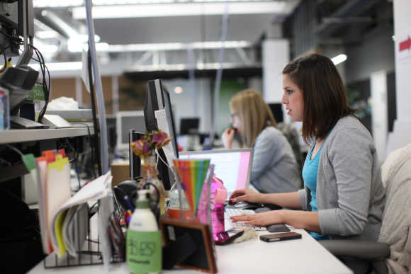 Facebook employees work in the design studio at the company's headquarters in Menlo Park, California.