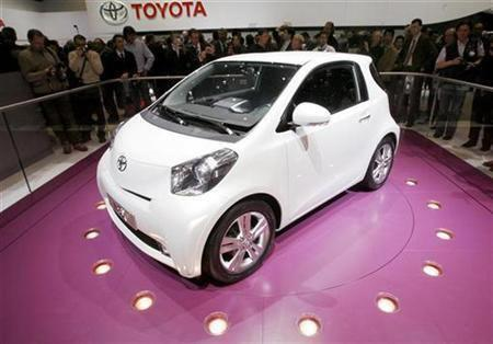 People watch the new Toyota iQ car.