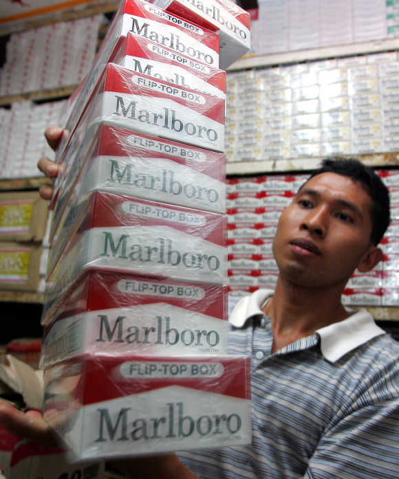 An Indonesian cigarette vendor displays cartons of Marlboro cigarettes in Jakarta.