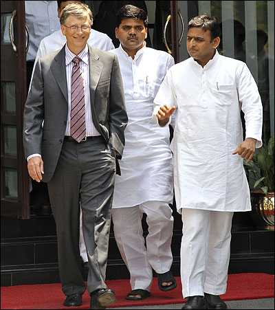 Akhilesh Yadav (R), chief minister Uttar Pradesh, talks to Microsoft co-founder Bill Gates as they walk together after their meeting in Lucknow.