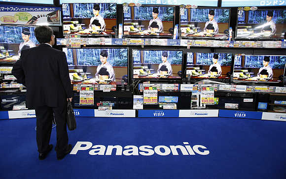 A man looks at Panasonic's Viera televisions displayed at an electronic store in Tokyo.