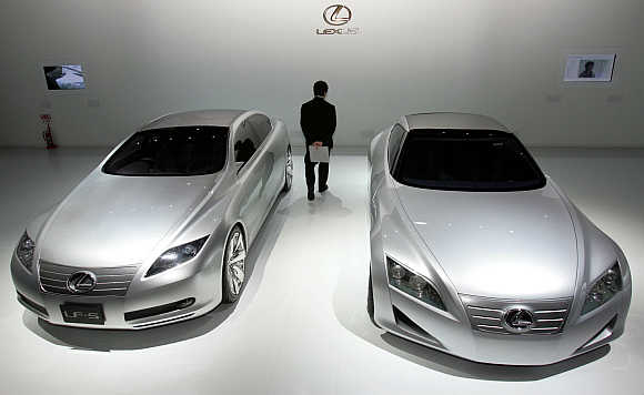 Toyota Motor Corp's Lexus brand concept vehicles LF-S, left, and LF-C, right, are displayed in Tokyo.