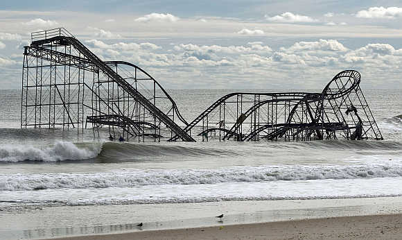 The remnants of a roller coast sits in the surf three days after Hurricane Sandy came ashore in Seaside Heights, New Jersey.