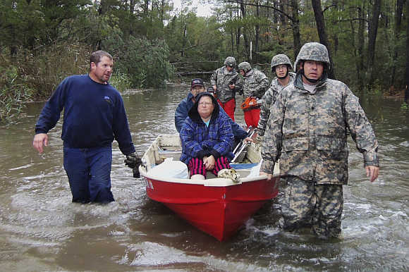 National Guard soldiers rescue people who were stranded in Mears, Virginia.