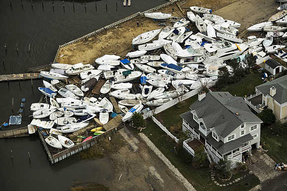 Boats are seen in a yard, where they washed onto shore during Hurricane Sandy, near Monmouth Beach, New Jersey.