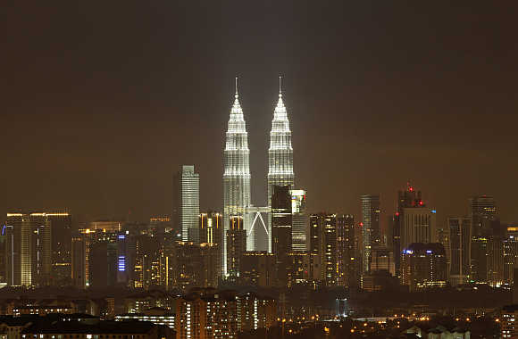 The Petronas Twin Towers in Kuala Lumpur after lights were turned on after the Earth Hour.