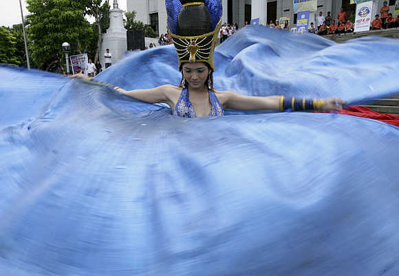 A dancer performs during the Kalesa Festival in Manila.