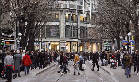 People walk on Zurich's main shopping street Bahnhofstrasse.