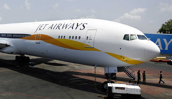 Jet Airways Boeing 777-300ER aircraft sits on the tarmac at Mumbai airport.
