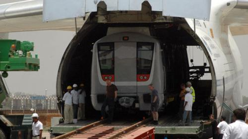 A Delhi-metro rail carriage is loaded into a cargo aircraft. The award-winning project has transformed the public transport system in the capital