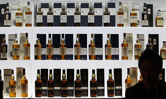 Bottles of malt whiskey are displayed at a merchandising event in Tokyo.