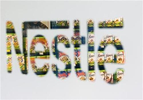 Nestle cereal boxes are pictured through a logo in the company supermarket at the Nestle headquarters in Vevey, Switzerland