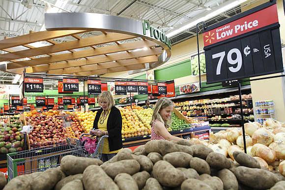 Customers shop at a Wal-Mart Neighbourhood Market store in Bentonville, Arkansas.