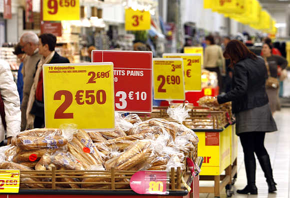 Discount signs are displayed in a Carrefour supermarket in Antibes, France.